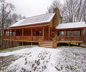 log cabin with side covered patio with jacuzzi