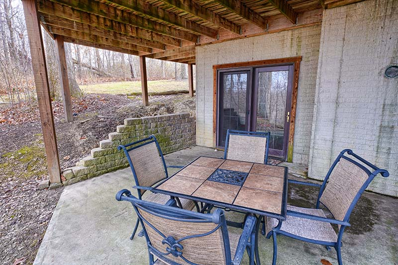 lower area outside, patio table and chairs