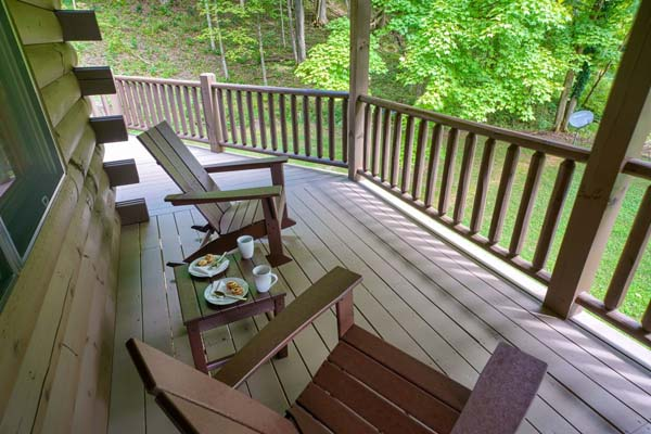 covered deck area with outdoor seating