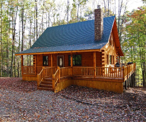 log cabin with green roof and large covered porch