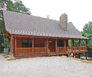 log cabin with side deck and jacuzzi