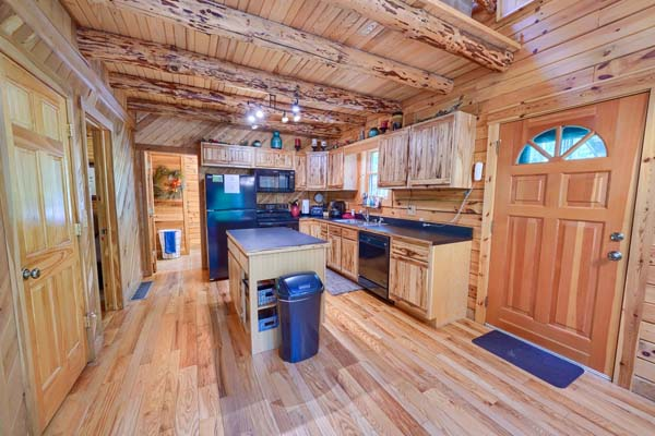 front door, kitchen with wood floor to ceiling cabin style