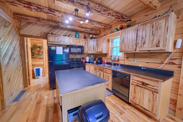 close up of kitchen, wood floor to ceiling cabin style