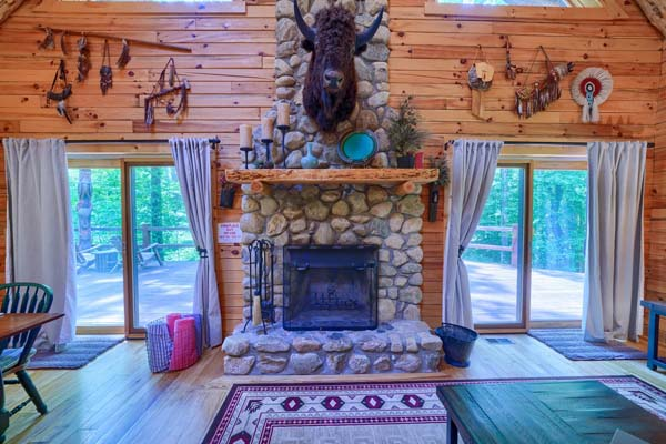 fireplace with buffalo hanging on mantel