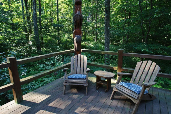 chairs on edge with wooded view
