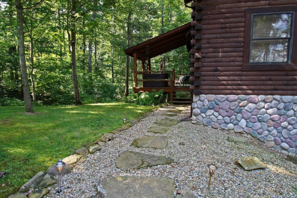 side view, back of property, stone side, stone walkway to back deck