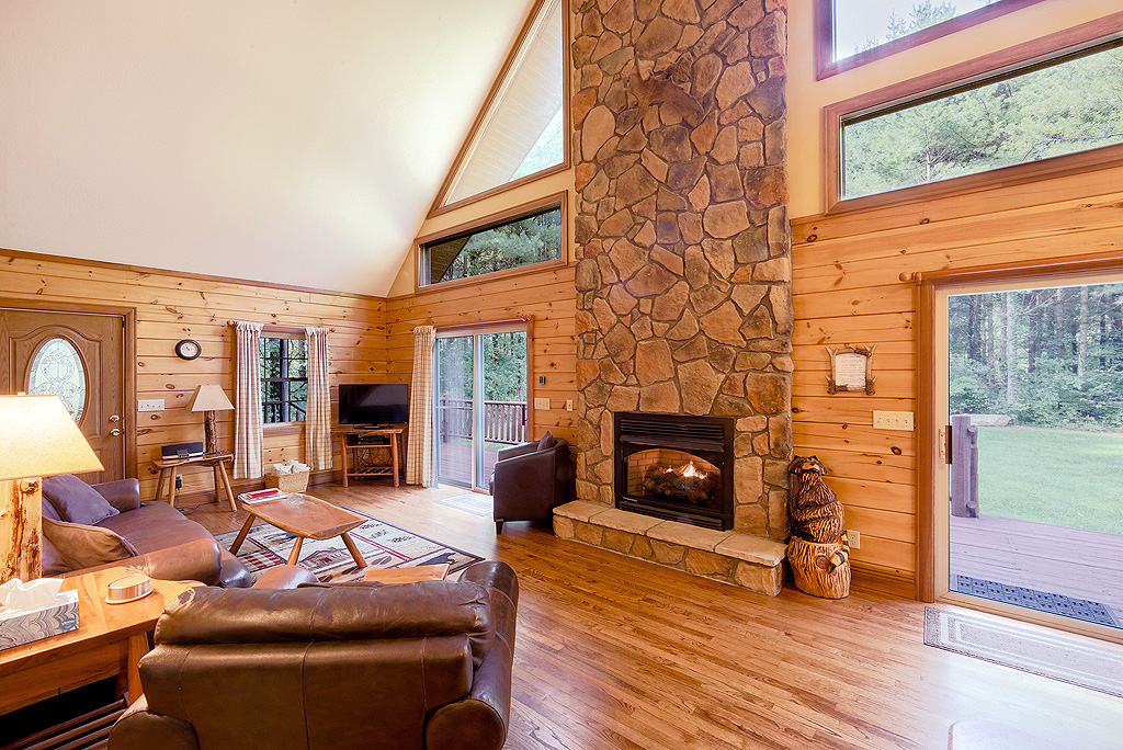 living roon, stone wall fireplace, windows