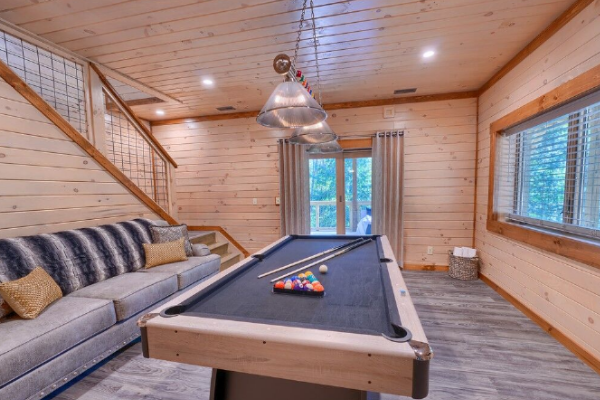 rec room in lower level with pool table