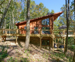 cabin in woods, deck, wrap around porch